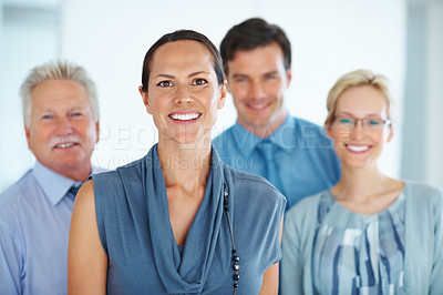 Buy stock photo Portrait of confident business woman smiling with her successful team