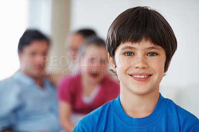 Buy stock photo Closeup portrait of young little boy with family in background