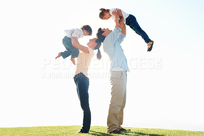 Buy stock photo Side view of loving parents carrying children on grass during weekend
