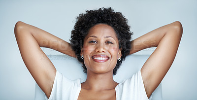 Buy stock photo Portrait of smiling African American woman relaxing with hands behind head