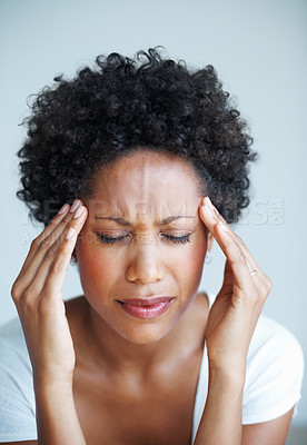 Buy stock photo Portrait of pretty woman holding head in pain