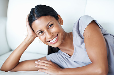 Buy stock photo Closeup of beautiful woman with great smile relaxing on couch