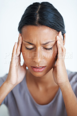 Buy stock photo Closeup of beautiful woman rubbing temples in pain