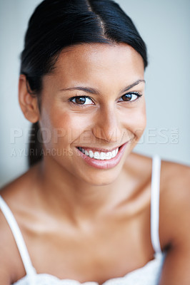 Buy stock photo Portrait of beautiful mixed race woman smiling on plain background