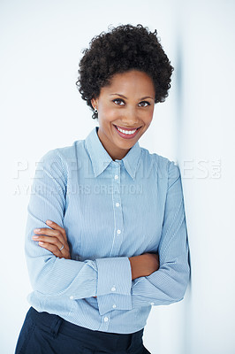 Buy stock photo Portrait of smiling business woman with hands folded leaning against wall
