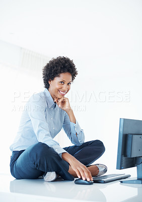 Buy stock photo Smiling business woman sitting on desk using computer