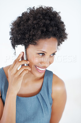 Buy stock photo Portrait of smiling African American woman speaking on cellphone on white background