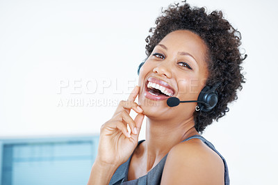 Buy stock photo Beautiful call center employee laughing while talking on headset