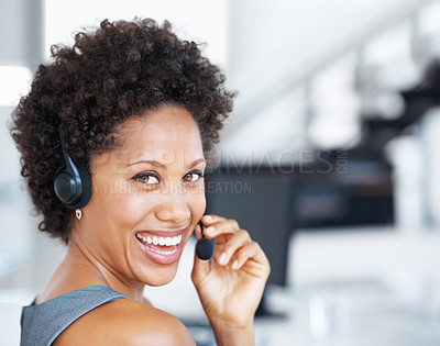 Buy stock photo Closeup of attractive call center agent laughing while talking on headset