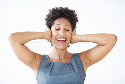 Buy stock photo Cheerful African American woman with eyes closed covering ears over white background