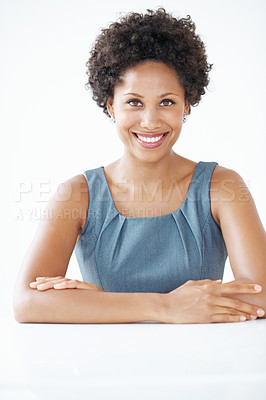 Buy stock photo Portrait of confident African American female executive smiling with hands folded