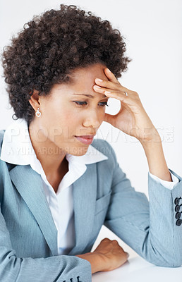 Buy stock photo Depressed African American business woman holding forehead