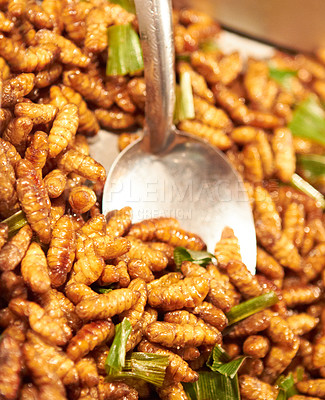 Buy stock photo Fried larvae at a street market in Thailand
