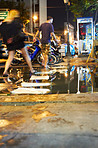 Tourist skipping over puddles in Thailand
