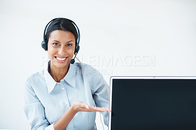 Buy stock photo Beautiful business woman presenting laptop over white background