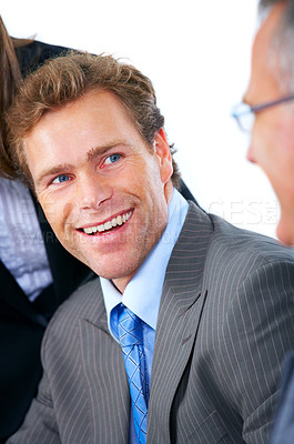 Buy stock photo Laughing business man at a meeting with his colleagues
