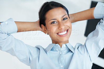 Buy stock photo Confident business woman smiling at you while relaxing at her office desk with her hands behind her head