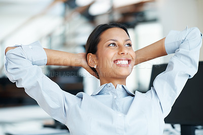 Buy stock photo Charming female executive relaxing in office chair with hands behind head