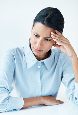 Buy stock photo Mixed race business woman at desk holding head under stress