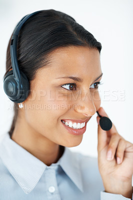 Buy stock photo Confident female call center employee looking away wearing headset