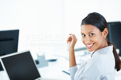 Buy stock photo Portrait of beautiful mixed race female executive smiling at computer desk