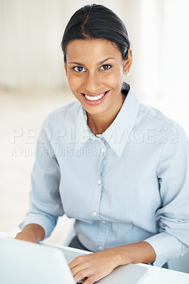 Buy stock photo Portrait of confident young business woman smiling while using laptop