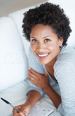 Buy stock photo High angle view of relaxed woman writing in diary at home