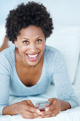 Buy stock photo Excited African American woman text messaging on couch