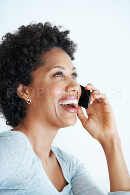 Buy stock photo Closeup of beautiful young woman laughing during phone call
