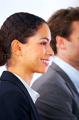 Buy stock photo Young woman at a conference, a college lecture or a meeting