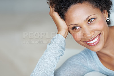 Buy stock photo Closeup of smiling young woman resting on couch looking away