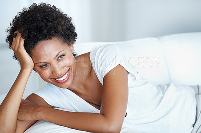 Buy stock photo Casually dressed African American woman relaxing at home