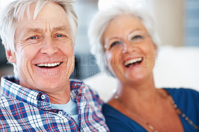 Buy stock photo Relaxed senior couple smiling with focus on man