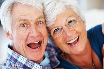 Buy stock photo Closeup of an aging senior couple looking happy and surprised