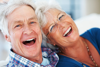 Buy stock photo Closeup of excited aging couple laughing together on couch