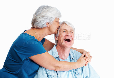 Buy stock photo Shot of a senior woman kissing her husband against his head over a white background