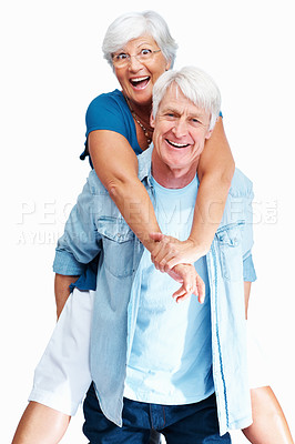 Buy stock photo Portrait of a senior man piggybacking his wife against a white background