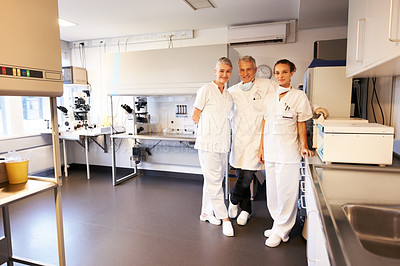 Buy stock photo Successful group of male and female scientist standing in research center