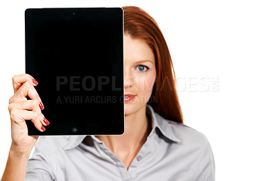 Buy stock photo Portrait of a young woman holding a digital tablet to cover half of her face