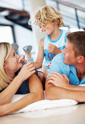 Buy stock photo Cute little boy having fun with parents at home