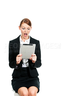 Buy stock photo A young executive staring at her digital tablet in shock and awe