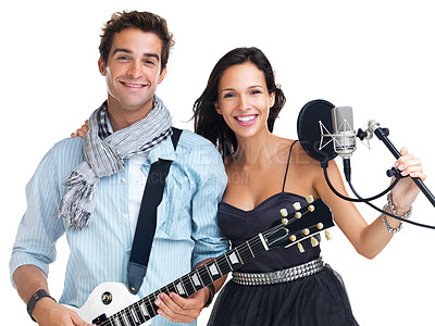 Buy stock photo Male guitarist and female singer smiling at the camera while standing in front of a microphone - isolated