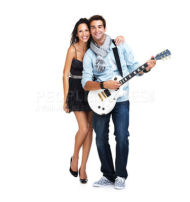 Buy stock photo Attractive young woman embracing her handsome boyfriend playing his electric guitar
