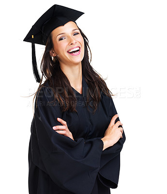 Buy stock photo Happy young woman wearing a graduation gown smiling at the camera with her arms folded