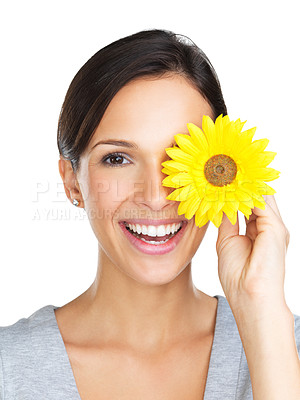 Buy stock photo Lovely brunette posing with a yellow gerber daisy covering her one eye