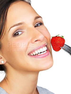 Buy stock photo Closeup of a beautiful brunette holding a strawberry on a fork - portrait