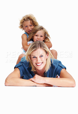 Buy stock photo Portrait of a woman lying on the floor with her children sitting on her back