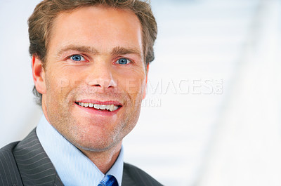 Buy stock photo Smiling businessman closeup in an office
