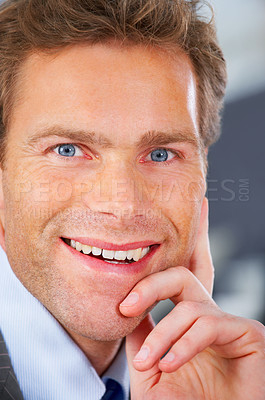Buy stock photo Close up of a mature and attractive business man sitting in a office