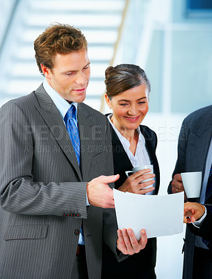 Buy stock photo Business team talking business - Business team at a meeting in a light and modern office.